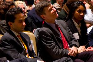 Josh Zivin, Jeffrey Sachs, and Anubha Agarwal sit